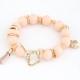 Licht Roze Kralen Met Gouden Bedeltjes Armband