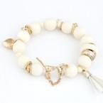 Witte Kralen Met Gouden Bedeltjes Armband